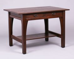 Gustav Stickley two-drawer library table.  Signed with red decal in drawer.  42″w x 29.5″d x 30″h