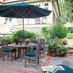 Small shifts in color or material supply welcoming visual interest underfoot on a patio. Consider a border, or use different sizes of stones to delineate seating or eating areas like this red brick helps designate the dining area and warms up the blue flagstones.