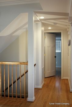 Bridge the gap from first floor to basement by tearing down part of the staircase wall and inserting a railing #home