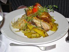 Csulok roasted pork shoulder joint with potatoes and sauerkraut