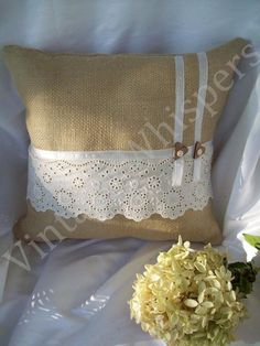 Burlap toss pillow with lace, ribbon and heart buttons