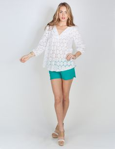 Our Kate blouse in white lace is the perfect top for your summer parties. Don't forget to pair it with our Lindy short! Available May 2013.