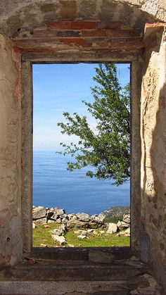 Anything derelict with a view of the ocean immediately has us in a sweat - and that's not the August weather. Window View, Open Window, Through The Window, Am Meer, Stairways, Windows And Doors, Nature Photos, Places To Go, Beautiful Places