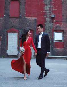 black tie wedding or formal party outfit idea - long red dress, navy tuxedo