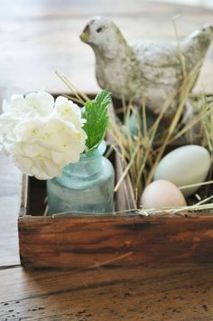 touches of spring for the table (I like the bits of straw with the natural eggs.  And the antique blue bottle)