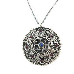 "Endless Circle is a 20"" Long Necklace With Oxidized Sterling Silver Chain and a Gun Metal Toggle. The Pendant is a 1 ½"" in Diameter Circle of German Silver and Finished in an Antiquing With Blue Lapis and Red Swarovski Crystal Embellishments. Product #15-082"