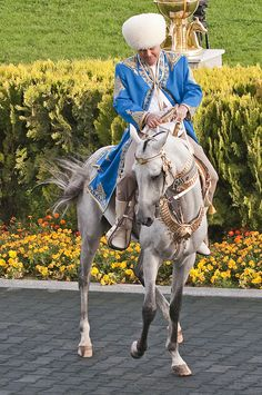 President of Turkmenistan with his favorite Akhal-Teke Stallion.