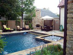 rectangular pool, hot tub and fireplace
