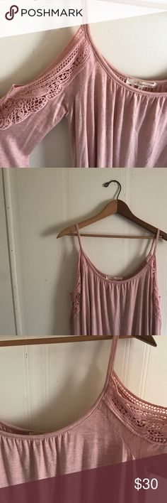 NWT Cold Shoulder Blush Top This top is brand new with tags. It is super cute on! I've decided that this color doesn't go with my wardrobe as well as I thought. I have a million Cold should tops and I'm letting this one go! It is a small, but it could fit larger as it is a loose fit. I would recommend someone that wears a medium and potentially a large for this top. Let me know if you have any questions! :) Rewind Tops Tees - Long Sleeve