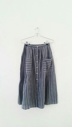 gray and white striped skirt with buttons and pockets