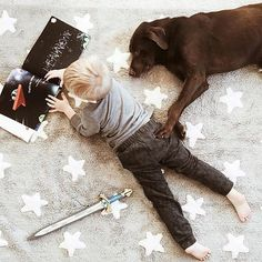 A boy, a dog, a book, sword and his grey stars machine-washable rug? What more does a boy need? Machine washable, non-toxic rug from Lorenacanals.com