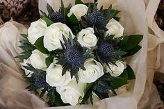 Blue Wedding Flowers Except with creamy/white gerbs. The black centered kind - Hi girls anyone having/had thistles (eryngium) in their bouquets? Christmas Wedding Flowers, Blue Wedding Flowers, White Wedding Bouquets, Bridal Flowers, Green Wedding, Bridesmaid Flowers, Bouquet Wedding, Wedding Colors, Thistle Bouquet