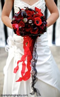Tim Burton inspired Halloween wedding. Gorgeous red and black bouquet with monster flowers. Photographed by D Park Photography