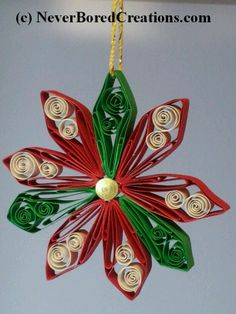 Christmas Poinsettia. An original design, hand quilled by Lisa. $8 plus $2.50 S&H. Mailed in USA only. www.neverboredcreations.com
