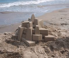 These insanely precise sand castles are bound to inspire (or utterly discourage) the efforts of casual beach-dwellers everywhere. See Bauhaus Architecture, Sand Play, Sand Sculptures, Colossal Art, Stage Set, Sand Art, Fishing Villages, Installation Art, Concept Art