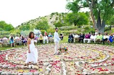 A wedding labyrinth - the couple starts out on opposite ends of the labyrinth and walk together toward the middle. After the ceremony they walk out together. I love this idea. It represents each persons journey alone toward marriage and the combined journey after marriage. It also necessitates that the guests be gathered around the couple, literally encompassing them in a circle of loved ones.