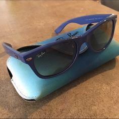 Ray-Ban Original Wayfarer Matte Sunglasses Ray-Ban's Original Wayfarer Matte sunglasses. Blue frames with blue/brown gradient lenses. Regular wear & tear on the frames & lenses as shown in the photos. Authentic Ray-Ban case included. Ray-Ban Accessories Sunglasses