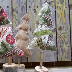 Cute rustic Christmas trees to make maybe using wine corks as stump screwed on to bottom wood