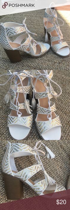"""Beautiful """"Indigo Rd"""" Pinka City Gold/White Sandal These gently used """"Indigo Rd. Pinka"""" Women's Sandals are so cute & comfy! Back zipper, lace entry, eye catching pattern & tassel details with fabric upper & block heel will have onlookers staring with envy! Parts of the laces where you tie them are slightly discolored from what seems to be makeup. See last picture. Otherwise, they are in perfect condition. Indigo Rd. Shoes Sandals"""