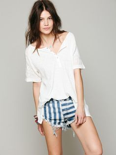 Oversized tee with floral embroidered detailing at each sleeve and stripy cut-offs