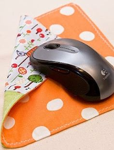 sew a mousepad from pretty scraps of fabric/ fabric that goes with your room! I would also laminate it to make sure it doesn't get dirty.