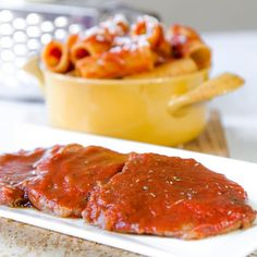 Slow cooked eye of round steaks with pizzaiola sauce are a classic Italian dish. The sauce is perfect to toss with pasta as well!