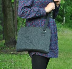 A pretty medium shoulder bag in grey dark color with gray cut tulip patter. Unique and remarkable.  With a two zipper closing to protect your