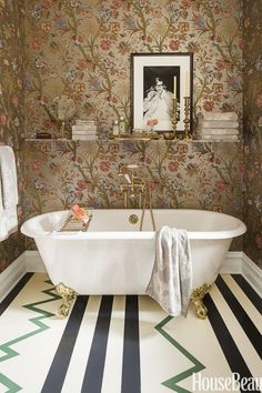 A restroom is the ideal place to have a little fun with décor. Instead of getting boxed into one aesthetic, designer Summer Thornton combines bold stripes with pleasant florals for this commode's unique, cheery appeal. Click through for more bathroom design inspiration from these dream bathrooms.