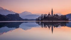 Yes, it's every bit as lovely in real life. With its emerald-green lake, picture-postcard church on an islet, a medieval castle clinging to a rocky...