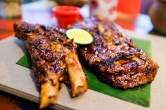 The signature char-grilled ribs at Naughty Nuri's work hard to live up to the legend of Ubud – marvellously tender (use your fingers to peel the flesh effortlessly off the bone), coated in a flavoursome, sticky-savoury-sweet BBQ sauce & coupled with a spicy chilli dressing.