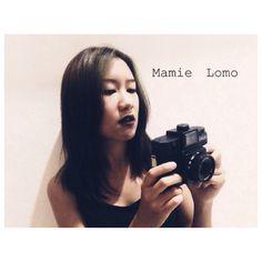 Owner and her holga at mamie lomo shop , Chiangmai , Thailand. Holga120n black.