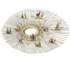 """Curtis Jere """"Birds over the Sun"""" metal sunburst wall sculpture.  The newest addition to our living room walls!"""