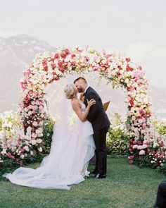 allie and joe italy wedding couple kissing beneath floral arch Wedding Exits, Wedding Music, Plan Your Wedding, Wedding Ceremony, Wedding Arches, Wedding Planning, Reception, Wedding Signs, Wedding Venues