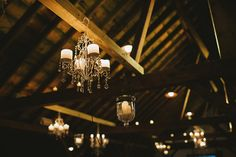 vintage lights in a barn setting at Riverside Farm, Vermont - Read more on One Fab Day: http://onefabday.com/autumn-wedding-by-michelle-gardella/