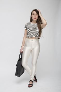 Audrey is wearing the Unisex Stripe Tee, The Disco Pant, Pearl, Sturdy Leather Tote by #AmericanApparel