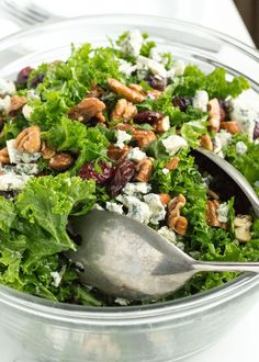 Lemony Kale Salad with Cranberries and Gorgonzola | nourishedtheblog.com | A simple and healthy recipe for a lemony kale salad with dried cranberries and gorgonzola and candied nuts. This easy to make salad is gluten free and vegetarian-friendly and the perfect side dish for any dinner.