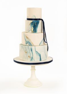 Dark blue marble cake with gold leaf
