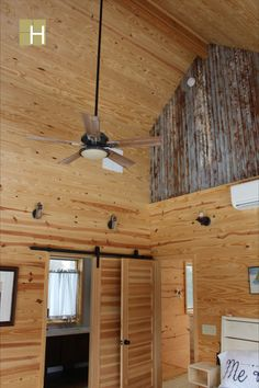 Interior view of master bedroom showing vaulted ceiling and galvanized metal decking for the upper walls. Decking was aged with pickle juice. Stained Concrete, Concrete Floors, Casement Windows, Windows And Doors, Sips Panels, Cedar Siding, Galvanized Metal, Metal Roof, Decking