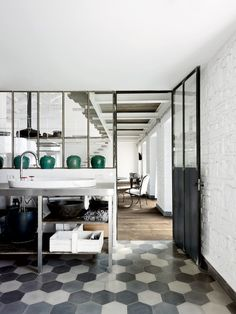 Really like the floor treatment Paola Navone's transformation of an old farmhouse in Italy into a unique rural loft.