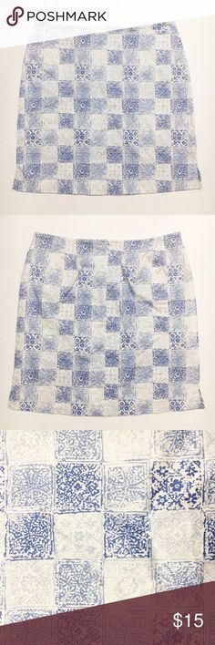 """Geoffrey Beene Blue Checkered Skirt Size 14 Geoffrey Beene Blue Checkered Skirt Size 14  Blue checkered patterned skirt from Geoffrey Beene Sport. Back zip closure. Very small slit on one side of the skirt. Used in excellent condition. Size 14.  Fabric Content: - 97% cotton, 3% spandex  Measurements (not doubled, approximate and taken with garment laid flat): - Waist: 16.75"""" - Hips: 21"""" - Hem width: 22.5"""" - Slit length: 2.5"""" - Total length: 20.5"""" Geoffrey Beene Skirts Mini"""