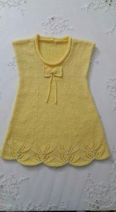 Lovely knitted yellow summer dress for girl
