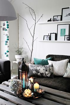 Small living room - small apartment - black + gray + teal or mint - centerpiece - wall art arrangement