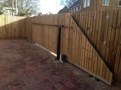 Wooden sliding gate installed and automated in Leicestershire.
