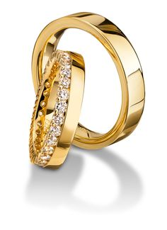 Yellow gold wedding bands from Furrer-Jacot available at Spitz Jewelers. https://www.facebook.com/SpitzJewelers