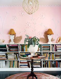 This library features seahorses throughout the room. The pink on the walls, decorated with seashells, is a custom mix that is fitting for this Miami home. Design: Gene Meyer and Frank de Biasi.