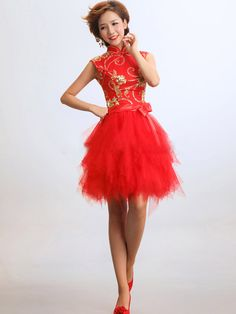 When wearing this red and gold sleeveless a-line tulle knee length dress you will feel as great as you look. Only the finest materials are used to make this dress. It is made from high quality scarlet red tapestry satin, yarn, tulle and gold sequins sequins. It is perfect for parties, dates and can even be worn to your prom.