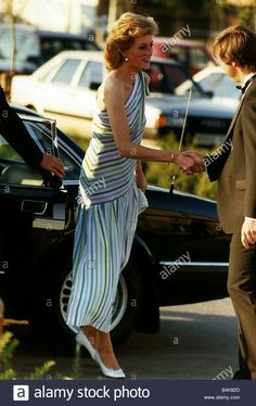 June 1989: Princess of Wales arriving at the David Lloyd tennis club wearing a stripped dress of blue white green and purple. Princess Diana first wore this dress in Majorca 1986.