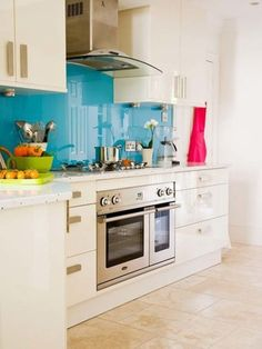 Various Kitchen Design for Your Home Inspiration: Ocean Blue Backsplash With White Kitchen Cabinet And Green Bowl ~ virtualhomedesign.net Kitchen Inspiration