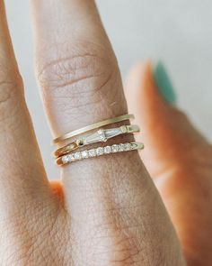 Stacker time! ⏰ FYI - Stackers can be wedding bands and wedding bands can be stackers! It all depends on how YOU style them. Featured Top to Bottom: 1mm Matte band (14k YG), Petite Tapered Baguette band (.24ctw, 14k YG), French Pavé band (.15ctw, 14k YG). Shop 'em online. Link in the BIO.