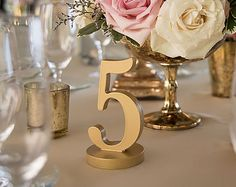 Wedding table numbers are a fun and unexpected pop of personality for your wedding. Our freestanding, handmade wooden wedding table numbers are carved in wood and painted in your choice of color. Choose your font, your color, and your base style for truly unique wedding table numbers. Whether you are looking for a vintage and rustic feel or are searching for a modern edge, we can customize the perfect wedding table number set for your wedding decor. Put some personality into your wedding…